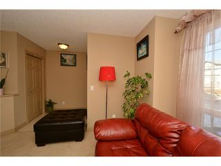 Photo 6: 202 ARBOUR MEADOWS Close NW in Calgary: Arbour Lake House for sale : MLS®# C4048885