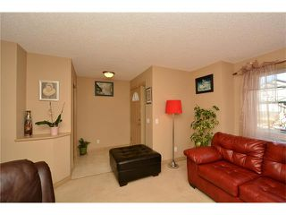 Photo 5: 202 ARBOUR MEADOWS Close NW in Calgary: Arbour Lake House for sale : MLS®# C4048885