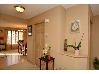 Photo 9: 202 ARBOUR MEADOWS Close NW in Calgary: Arbour Lake House for sale : MLS®# C4048885