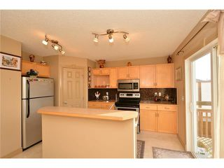 Photo 13: 202 ARBOUR MEADOWS Close NW in Calgary: Arbour Lake House for sale : MLS®# C4048885