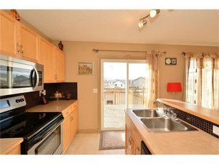 Photo 15: 202 ARBOUR MEADOWS Close NW in Calgary: Arbour Lake House for sale : MLS®# C4048885