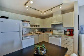 "Photo 5: 405 7505 138 Street in Surrey: East Newton Condo for sale in ""Midtown Villas"" : MLS®# R2041592"