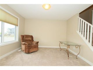 Photo 4: 7 FIRESIDE Parkway: Cochrane House for sale : MLS®# C4068645