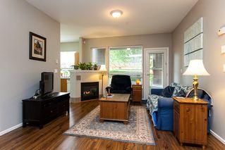 "Photo 2: 114 20259 MICHAUD Crescent in Langley: Langley City Condo for sale in ""City Grande"" : MLS®# R2206545"