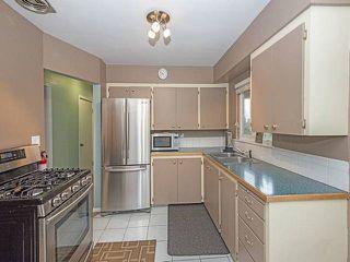 Photo 3: 950 QUADLING Avenue in Coquitlam: Maillardville House for sale : MLS®# R2037254