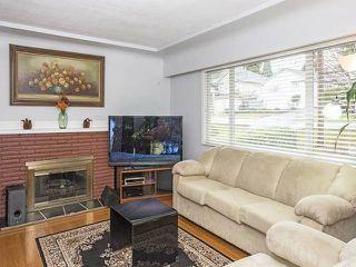 Photo 2: 950 QUADLING Avenue in Coquitlam: Maillardville House for sale : MLS®# R2037254