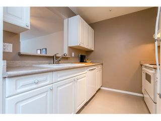 "Photo 6: 311 14885 100 Avenue in Surrey: Guildford Condo for sale in ""THE DORCHESTER"" (North Surrey)  : MLS®# R2042537"