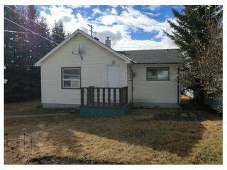 Photo 2: 204 CENTRE Avenue: Cochrane House for sale : MLS®# C4055784