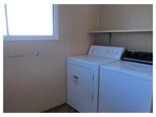 Photo 15: 204 CENTRE Avenue: Cochrane House for sale : MLS®# C4055784