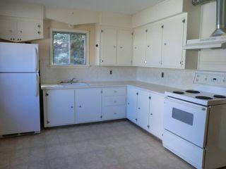 Photo 9: 204 CENTRE Avenue: Cochrane House for sale : MLS®# C4055784