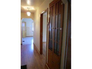 Photo 12: 204 CENTRE Avenue: Cochrane House for sale : MLS®# C4055784