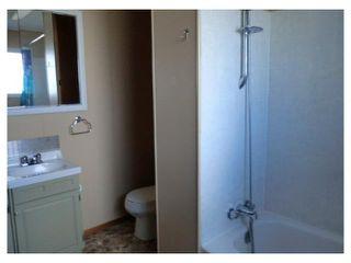 Photo 14: 204 CENTRE Avenue: Cochrane House for sale : MLS®# C4055784