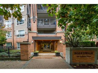 "Photo 1: 410 700 KLAHANIE Drive in Port Moody: Port Moody Centre Condo for sale in ""BOARDWALK"" : MLS®# R2117002"