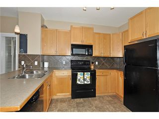 Photo 8: 5701 111 TARAWOOD Lane NE in Calgary: Taradale House for sale : MLS®# C4110384