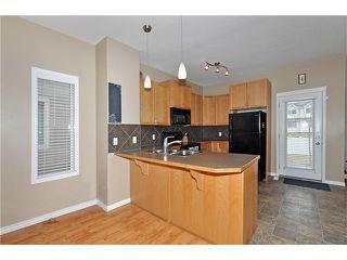 Photo 6: 5701 111 TARAWOOD Lane NE in Calgary: Taradale House for sale : MLS®# C4110384