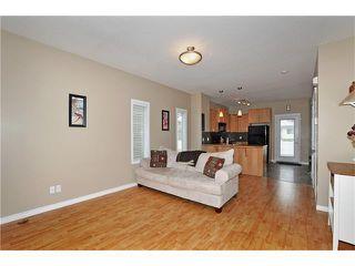 Photo 4: 5701 111 TARAWOOD Lane NE in Calgary: Taradale House for sale : MLS®# C4110384