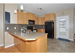 Photo 10: 5701 111 TARAWOOD Lane NE in Calgary: Taradale House for sale : MLS®# C4110384