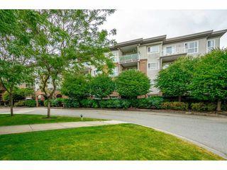 "Photo 1: 408 15895 84 Avenue in Surrey: Fleetwood Tynehead Condo for sale in ""Abbey Road"" : MLS®# R2384828"