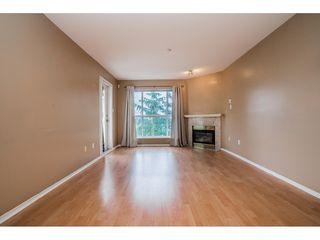 "Photo 3: 408 15895 84 Avenue in Surrey: Fleetwood Tynehead Condo for sale in ""Abbey Road"" : MLS®# R2384828"