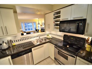 "Photo 2: 222 2545 W BROADWAY in Vancouver: Kitsilano Townhouse for sale in ""TRAFALGAR MEWS"" (Vancouver West)  : MLS®# V1097981"