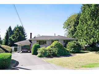 Photo 1: 1672 HARBOUR Drive in Coquitlam: Harbour Place House for sale : MLS®# V1139870