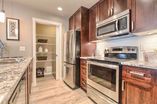 "Photo 10: 410 2238 WHATCOM Road in Abbotsford: Abbotsford East Condo for sale in ""WATERLEAF"" : MLS®# R2008635"
