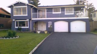 Photo 1: 12722 90 Avenue in Surrey: Queen Mary Park Surrey House for sale : MLS®# R2117929