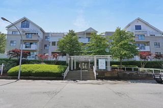 """Photo 1: 101 20268 54 Avenue in Langley: Langley City Condo for sale in """"BRIGHTON PLACE"""" : MLS®# R2147886"""