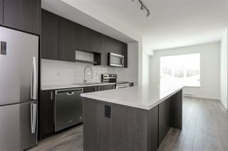 "Photo 2: 130 8130 136A Street in Surrey: Bear Creek Green Timbers Townhouse for sale in ""KINGS LANDING"" : MLS®# R2181571"