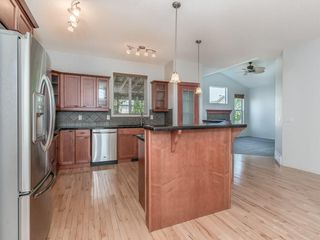 Photo 11: 344 CRIMSON Close: Chestermere House for sale : MLS®# C4136923