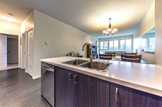 "Photo 3: 404 1135 WINDSOR Mews in Coquitlam: New Horizons Condo for sale in ""Bradley House at Windsor Gate"" : MLS®# R2237566"