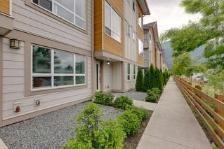 "Photo 1: 9 1188 WILSON Crescent in Squamish: Dentville Townhouse for sale in ""The Current"" : MLS®# R2269962"