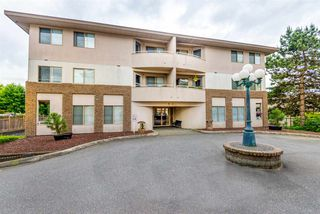 """Photo 1: 101 19130 FORD Road in Pitt Meadows: Central Meadows Condo for sale in """"BEACON SQUARE"""" : MLS®# R2276888"""
