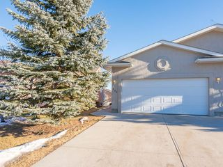 Photo 1: 680 SHEEP RIVER Mews: Okotoks Semi Detached for sale : MLS®# C4222946