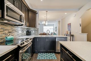 """Photo 2: 135 19525 73 Avenue in Surrey: Clayton Townhouse for sale in """"Uptown 2"""" (Cloverdale)  : MLS®# R2341960"""