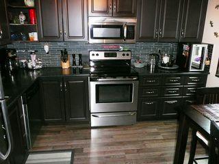 "Photo 3: 24 1140 EAGLERIDGE Drive in Coquitlam: Eagle Ridge CQ Townhouse for sale in ""Eagle Ridge"" : MLS®# R2386010"