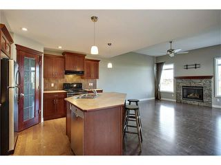 Photo 8: 788 Luxstone Landing SW: Airdrie House for sale : MLS®# C4083627