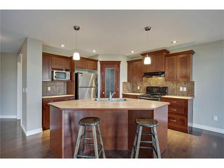 Photo 10: 788 Luxstone Landing SW: Airdrie House for sale : MLS®# C4083627