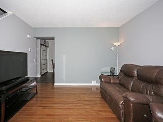Photo 12: 121 999 CANYON MEADOWS Drive SW in Calgary: Canyon Meadows House for sale : MLS®# C4113761