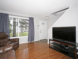 Photo 8: 121 999 CANYON MEADOWS Drive SW in Calgary: Canyon Meadows House for sale : MLS®# C4113761