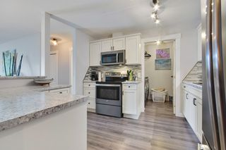 "Photo 2: 406 33688 KING Road in Abbotsford: Poplar Condo for sale in ""College Park"" : MLS®# R2199460"