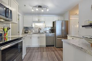"Photo 4: 406 33688 KING Road in Abbotsford: Poplar Condo for sale in ""College Park"" : MLS®# R2199460"