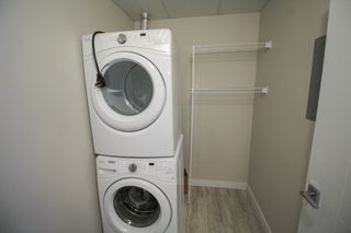 Photo 21: Gorgeous corner unit with wrap around balcony. 1 Underground parking stall included. Pet friendly building.