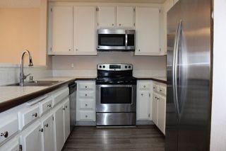 Photo 2: RANCHO BERNARDO Condo for sale : 2 bedrooms : 12515 Oaks North Dr #130 in San Diego