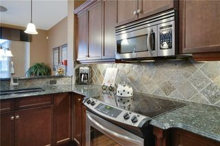 Photo 9: 36 ASPEN HILLS Close SW in Calgary: Aspen Woods Detached for sale : MLS®# C4223574