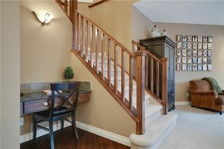 Photo 12: 36 ASPEN HILLS Close SW in Calgary: Aspen Woods Detached for sale : MLS®# C4223574