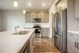 Photo 2: 7939 ERASMUS Crescent in Edmonton: Zone 57 House for sale : MLS®# E4160995
