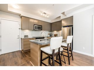 "Photo 9: 104 6420 194 Street in Surrey: Clayton Condo for sale in ""WATERSTONE"" (Cloverdale)  : MLS®# R2480446"