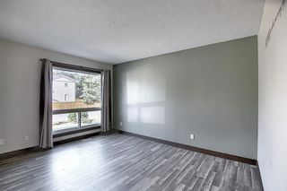 Photo 10: 72 DEERPOINT Road SE in Calgary: Deer Ridge Row/Townhouse for sale : MLS®# A1029747