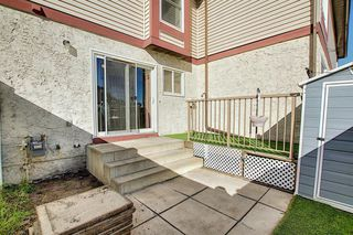 Photo 24: 72 DEERPOINT Road SE in Calgary: Deer Ridge Row/Townhouse for sale : MLS®# A1029747